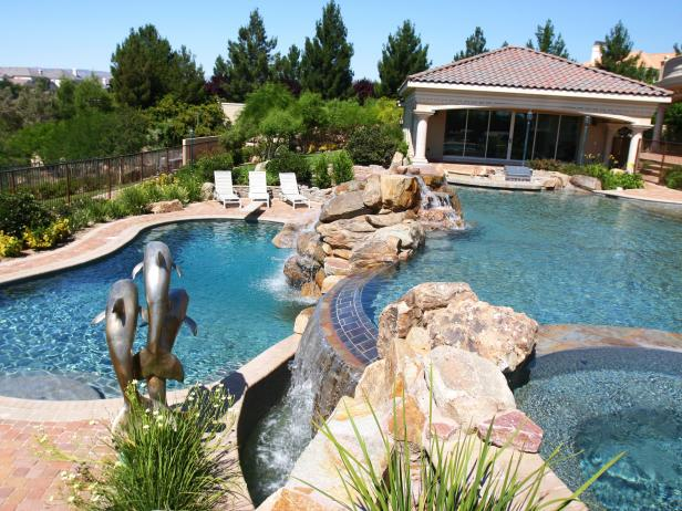 Multi-Level Pool Area with Stone Accents and Water Feature