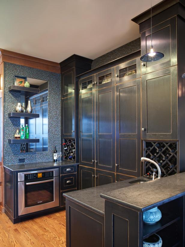 Pass-Through Kitchen With Dark Cabinets & Wine Racks