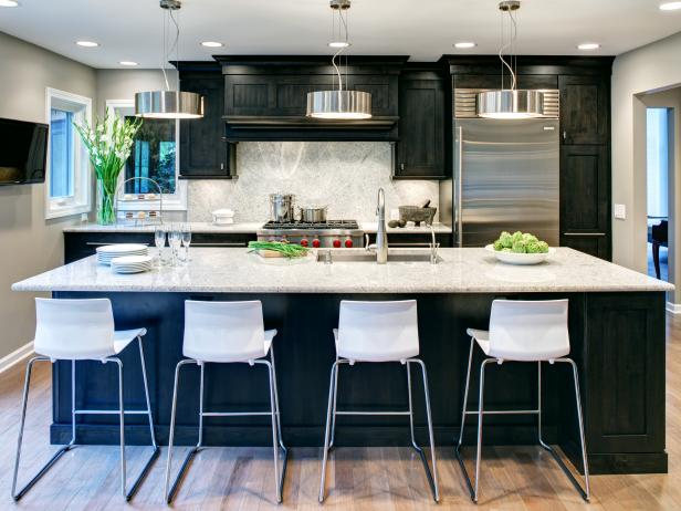 Kitchen With Dark Cabinets, Dark Island, Light Counters & White Stools
