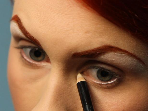 Add white eyeliner pencil at the inner corners of eyes and blend out onto lid.