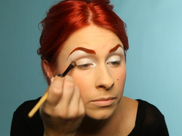 Add a light brown eye shadow to the outside corner of lids.