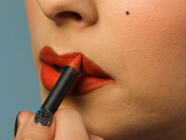 Fill in lips with bright red pencil liner.