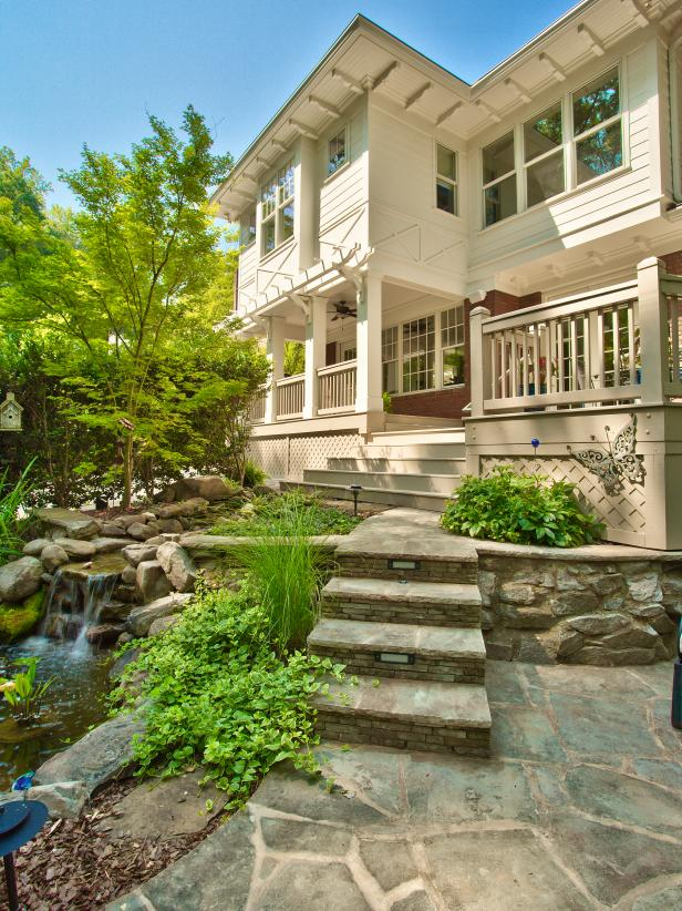 Craftsman Home Exterior With Pond, Stone Stairs and Retaining Wall