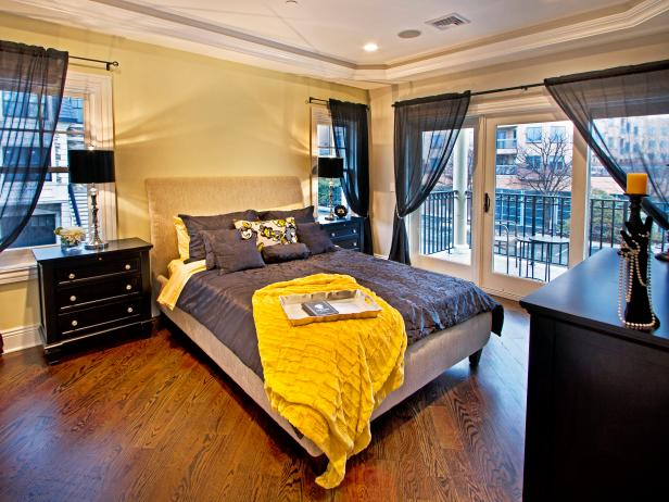 Black and Yellow Eclectic Bedroom With Patio View