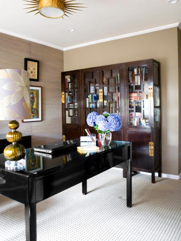 Neutral Home Office With Black Desk, Brass Light Fixture, Brown Curio