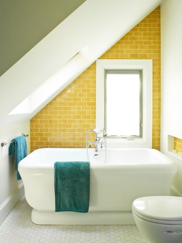Modern Bathroom With Angled Ceiling, Yellow Wall Tile and Hexagonal Floor Tile