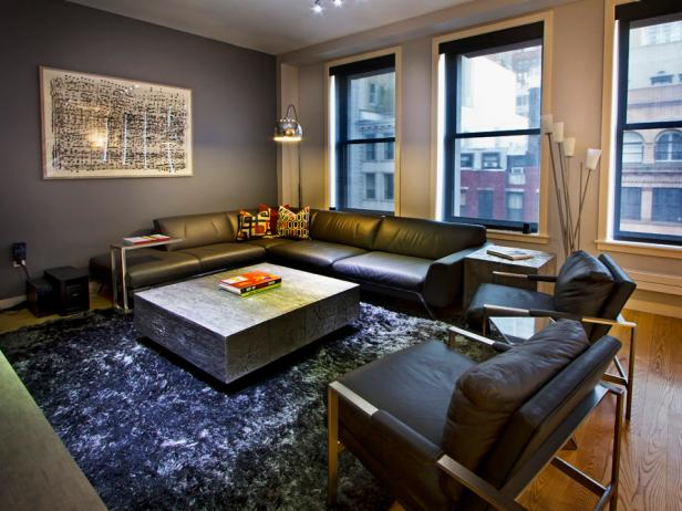 Gray Living Room With Leather Sofa, Chairs and Metal Coffee Table