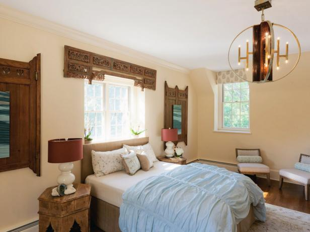 Neutral Eclectic Bedroom With Reclaimed Wood Accents and Chandelier