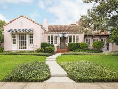 Pink Mediterranean Home Exterior With Striped Awning