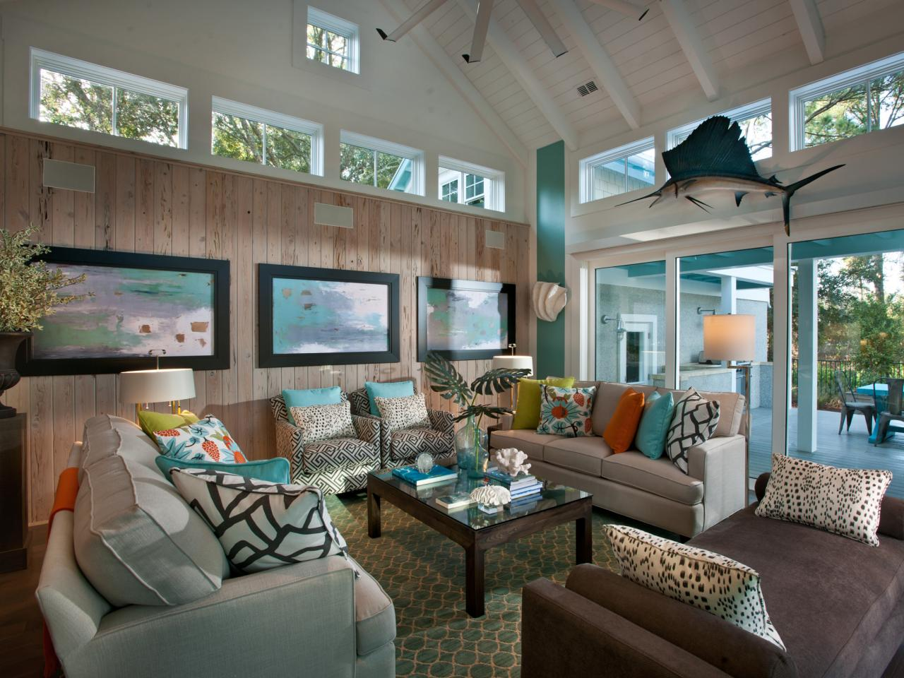 Coastal living room with neutral sofas and brown chaise telescoping glass doors open to the home - Airy brown and cream living room designs inspired from outdoor colors ...