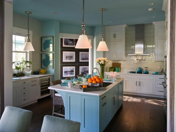 Light Blue Kitchen With White Cabinets, Blue Island and Pendant Lights