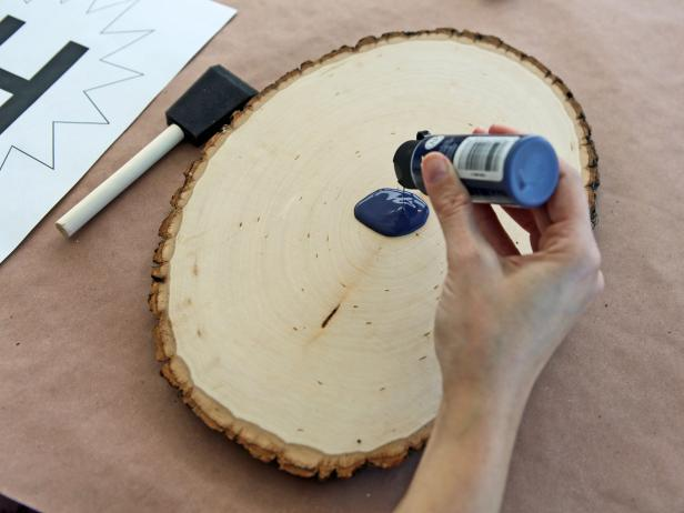 Use foam paintbrush to apply a thin coat of acrylic paint to wood plaque
