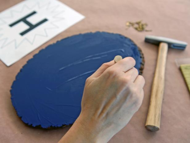Use foam paintbrush to apply a thin coat of acrylic paint to wood plaque.