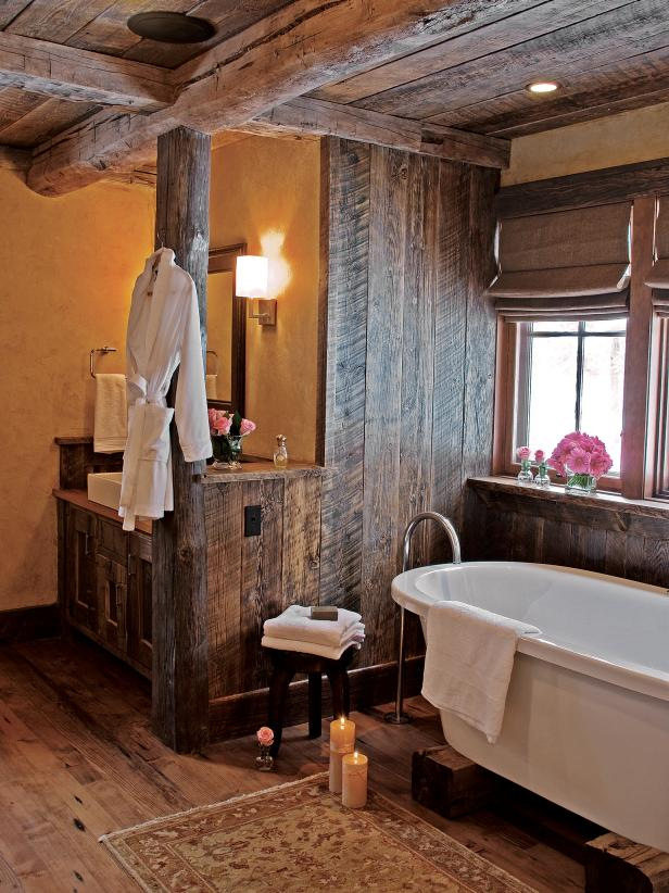 rustic bathroom with wood ceiling and walls plus soaking tub