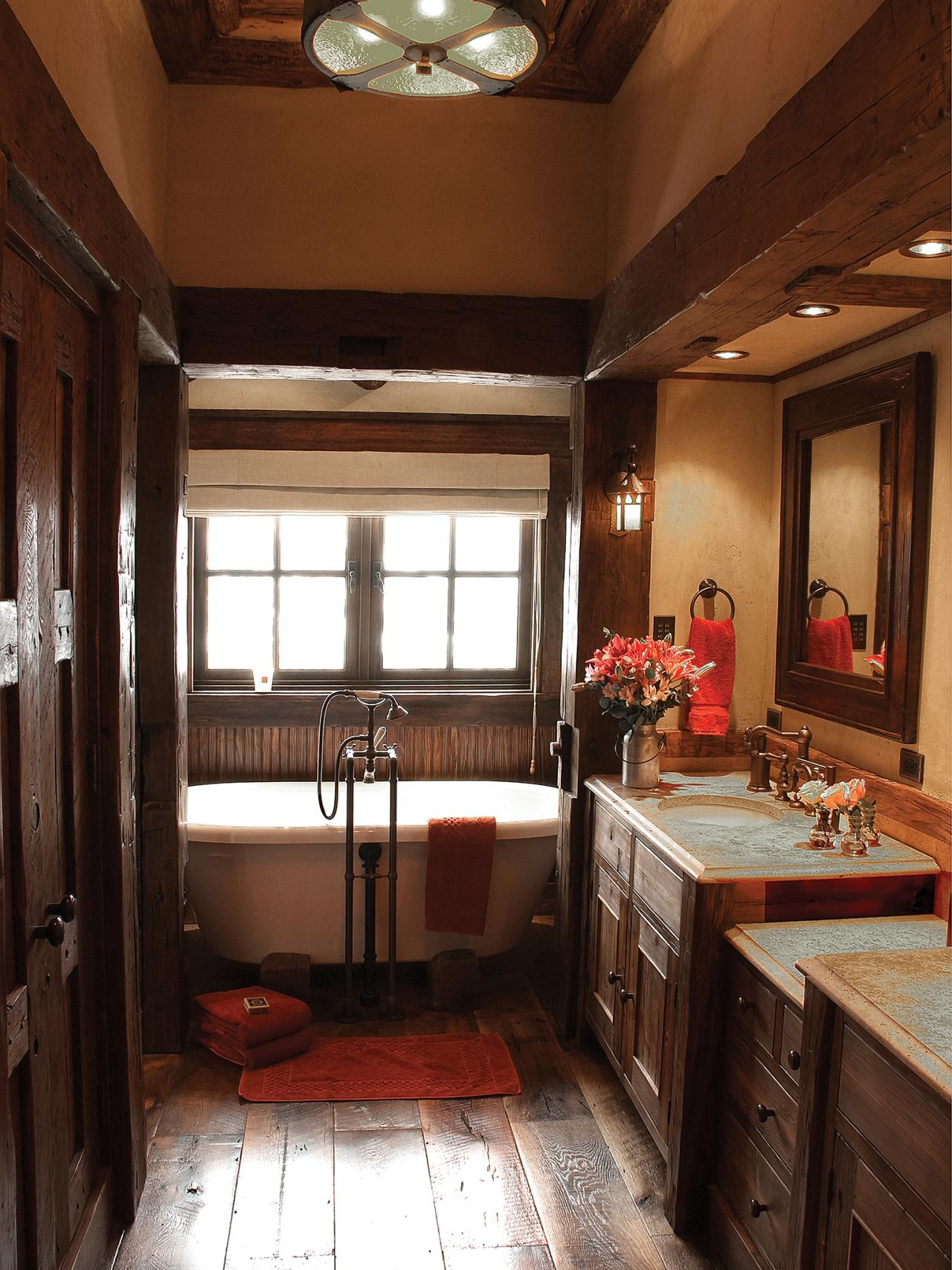 rustic bathroom with clawfoot soaking tub this rustic master bathroom