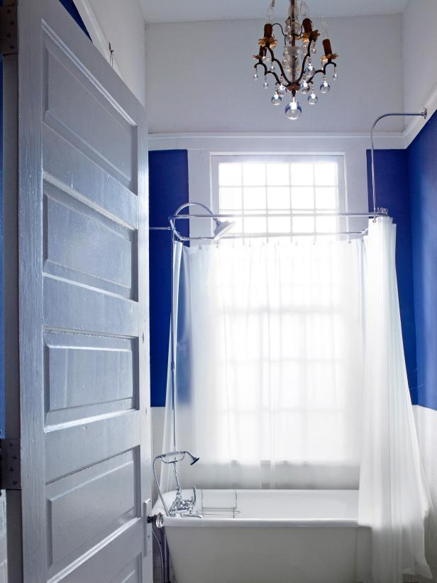 royal blue bathroom with white slipper tub - Small Space Bathroom Design