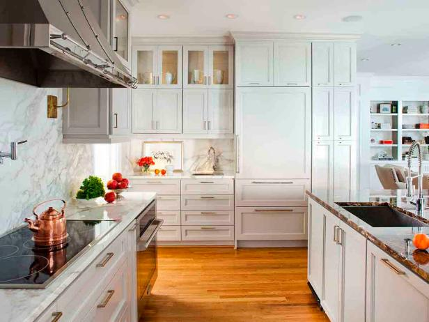 White Modern Kitchen With Marble Countertops and Inset Cabinets