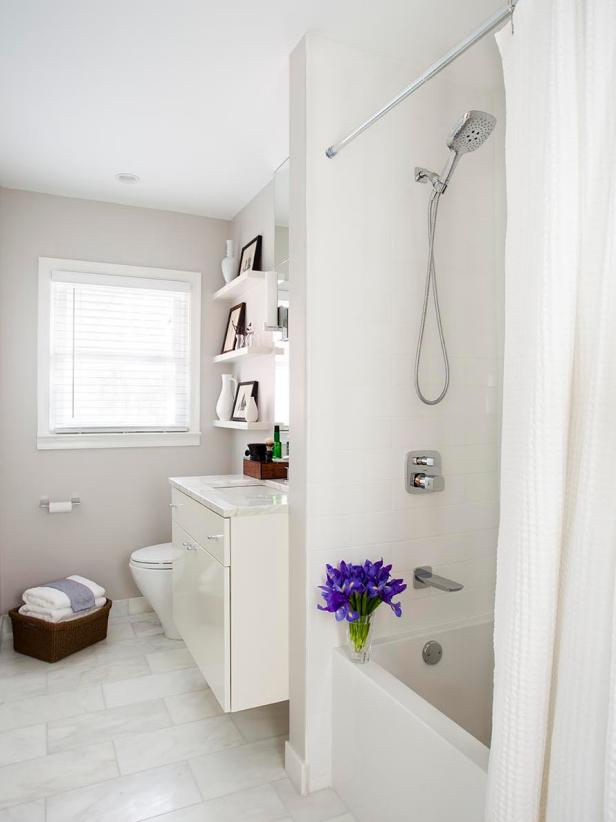 All-White Contemporary Bathroom With Purple Iris