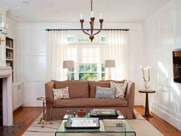 Tan Sofa and Clear Coffee Table in Transitional White Living Room