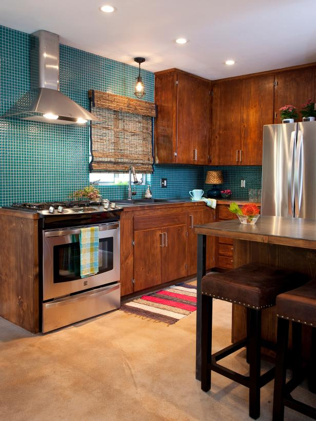 Kitchen With Teal Mosaic Tile, Wood Cabinets and Stainless Appliances