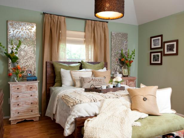 Mint Country Bedroom With Laminate Flooring and Throw Pillows