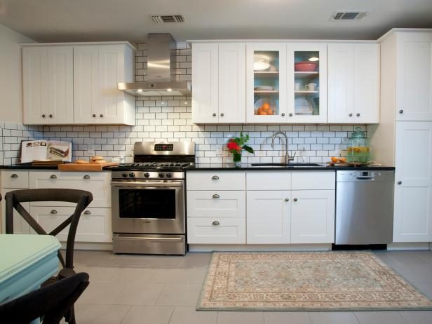 White Kitchen With Subway Tile Backsplash and Black Countertops