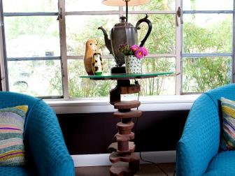 Eclectic Side Table With Blue Club Chairs
