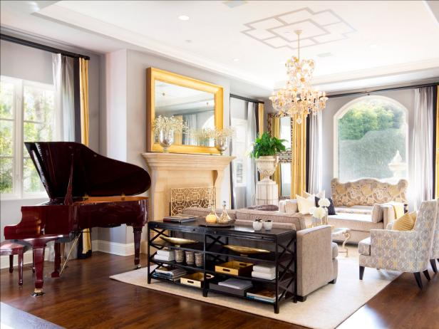 Gray Living Room with Gold Mirror, Crystal Chandelier and Piano