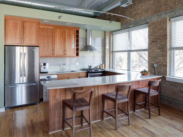 Green Contemporary Eat-In Kitchen With Brick Wall and Exposed Ductwork