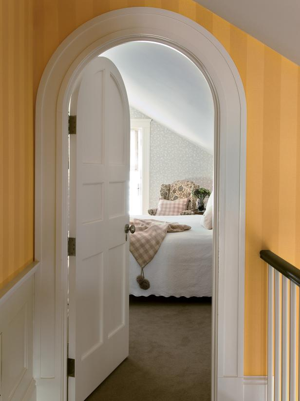 Arched Doorway with Yellow Striped Wallpaper