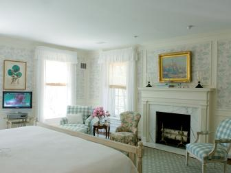 French Country Bedroom With Marble Fireplace