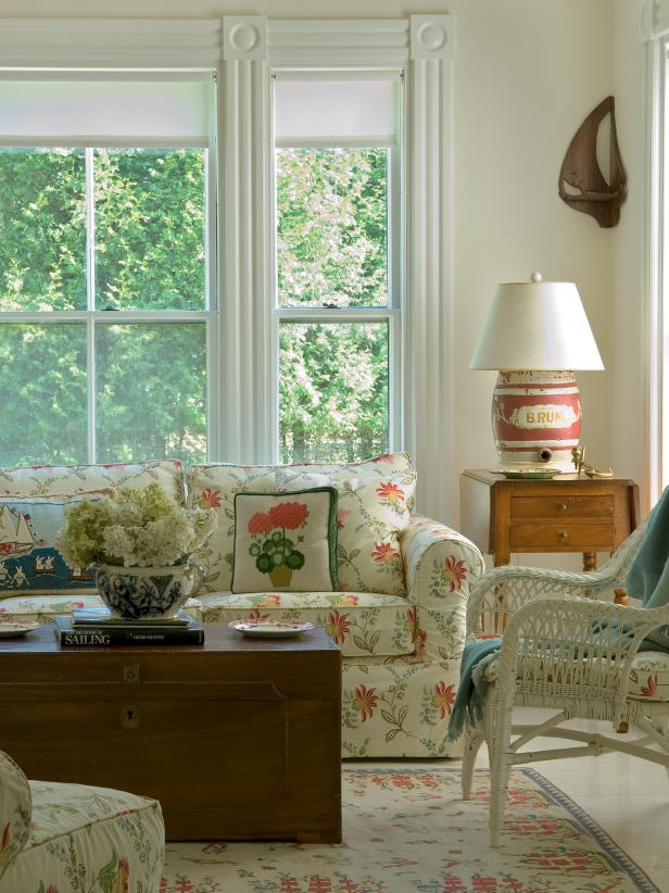 Bright Sunroom With Floral Sofa and Coffee Table Chest