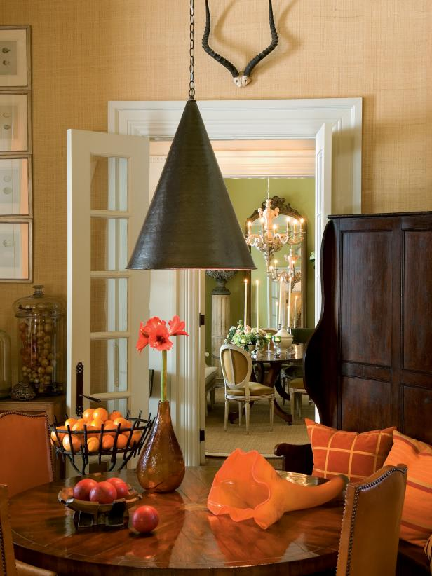 Dining Nook With Wood Dining Table, Cone Light Fixture & Orange Tones