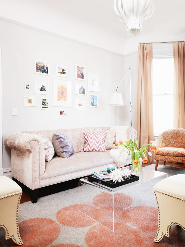 Peach Eclectic Living Space With Wall of Framed Artwork and Prints