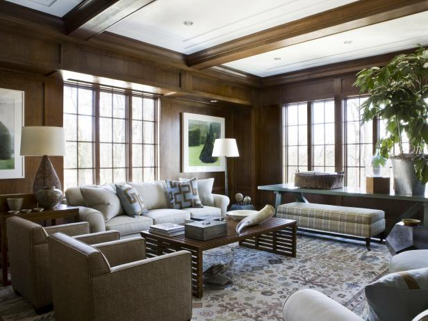 Transitional Home Library With Wood Panel Walls and Ceiling Beams