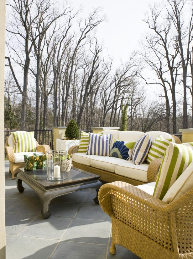 Outside Loggia Patio Area With Rattan Seating and Plush Pillows