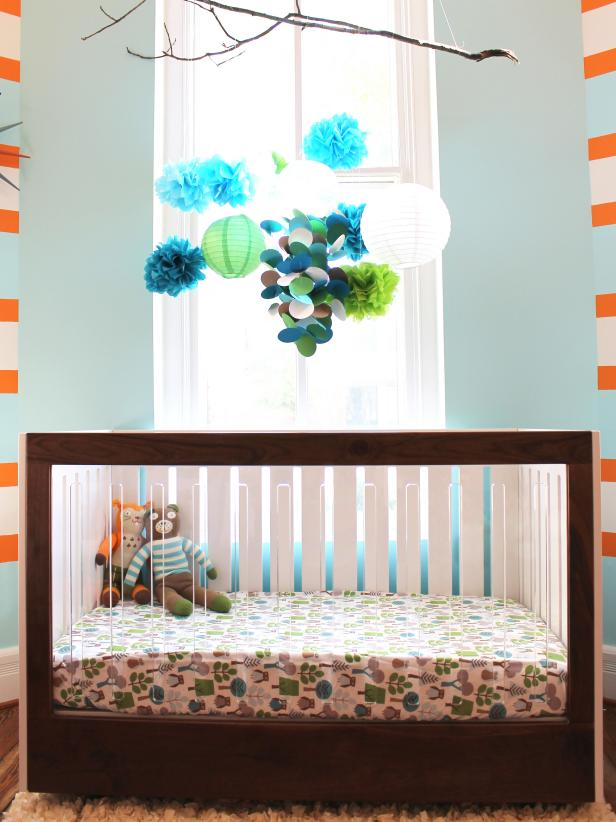 Modern Blue Nursery With Walnut Crib and Tree Branch Mobile