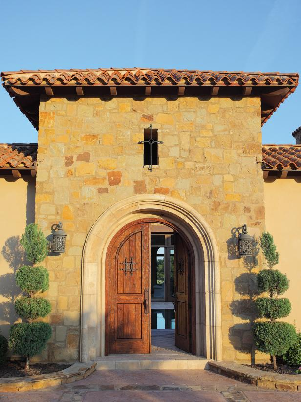 Wood front doors on Mediterranean home