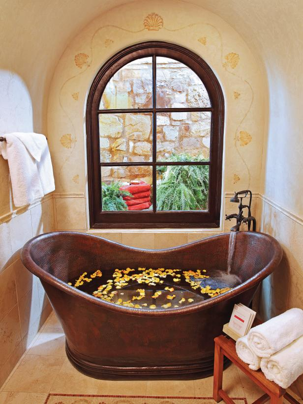 Mediterranean Bathroom With Copper Soaking Tub