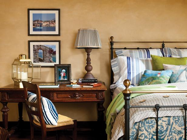 Coastal Bedroom With Wooden Desk and Iron Bed Frame