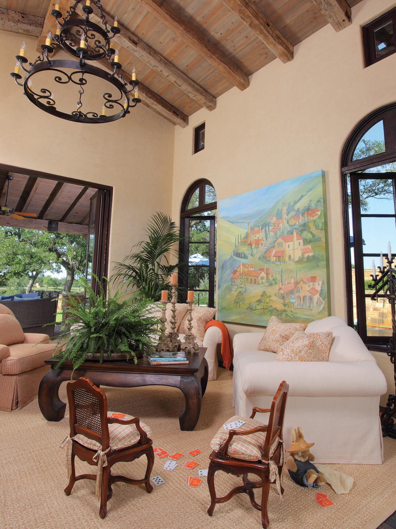 Mediterranean living room with high beamed ceiling hgtv - Pictures of decorated living rooms ...
