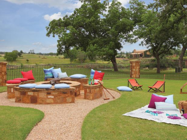 Stone Benches And Cushion Seating On Rustic Fire Pit