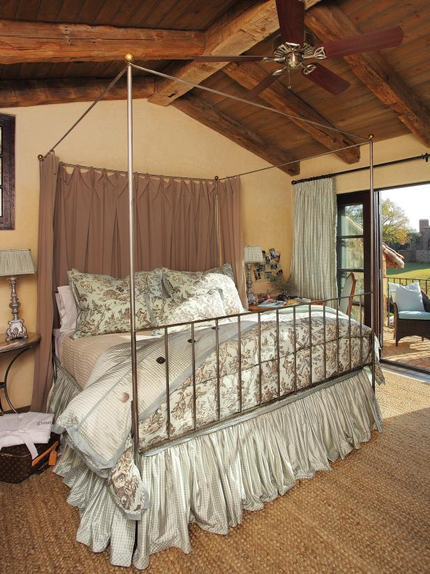 Rustic Bedroom With Outdoor Seating Area