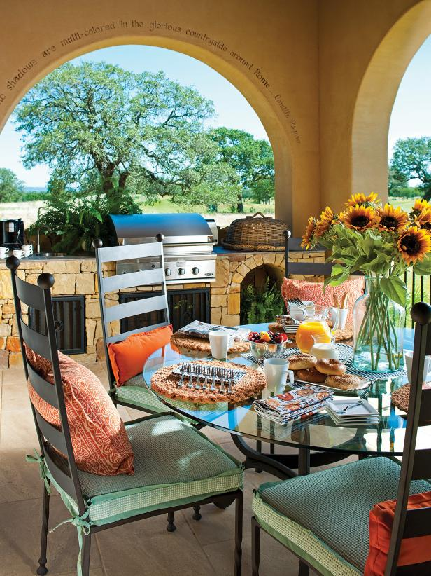 Mediterranean Outdoor Kitchen and Dining Area