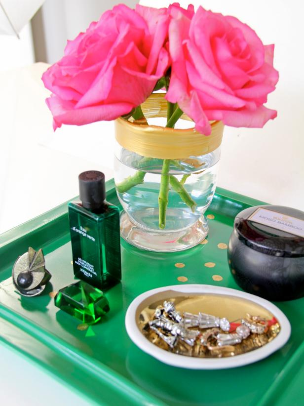 This hand-painted vanity tray is a perfect storage container for small items that guests can use during their stay. It was transformed to stylish functionality with a porcelain plate, downloaded printable, carbon paper and a gold leaf pen--and, of course, the handiwork of the creator.