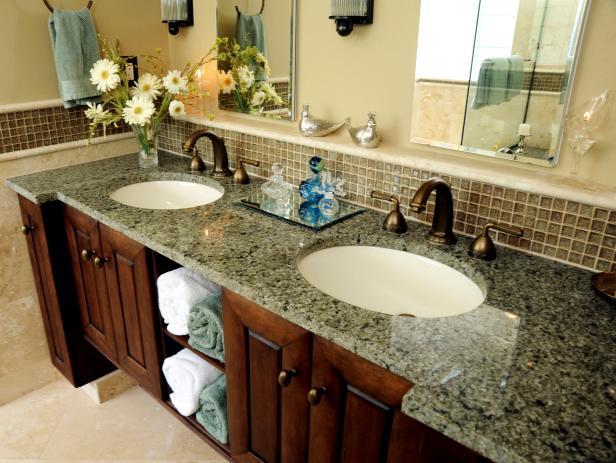 Bathroom With Granite Countertops and Dark Stained Wood Vanity
