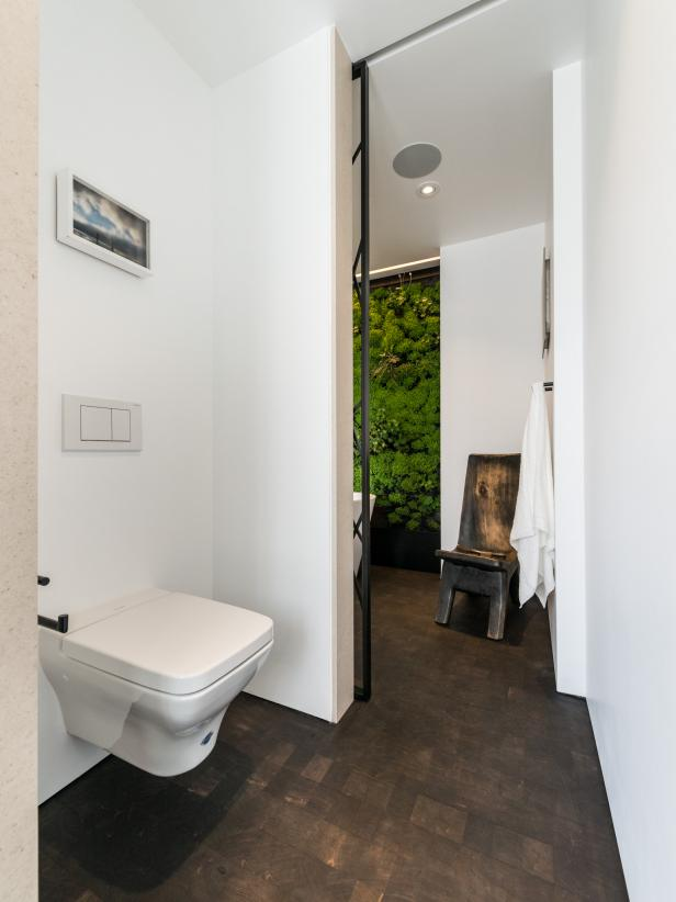 White Bathroom With Private Toilet Area and Brown Floor Tiles
