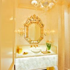 Monochromatic Gold Powder Room with Black Marble Tile