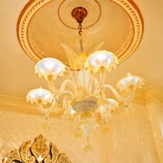 Ceiling With Gold Molding and Chandelier