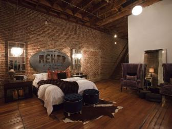 Bedroom with Brick Walls and Open Ceiling